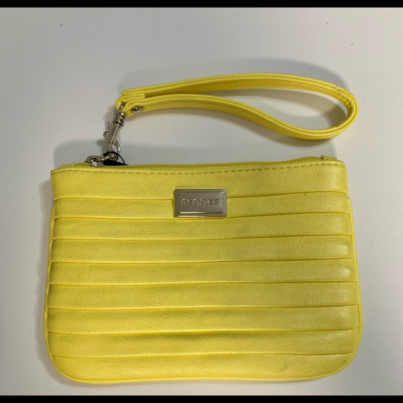 Express wristlet for women's yellow,new with tags.